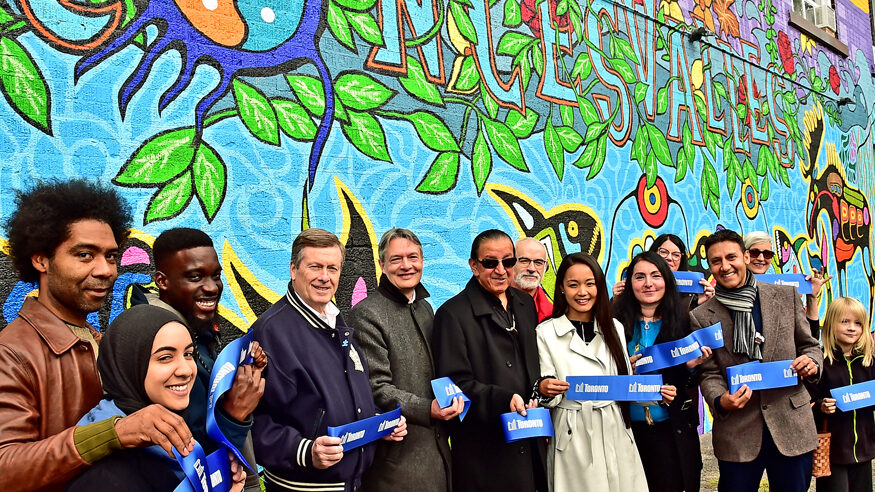 The mural artists, assistant, apprentices, elected rep and others cut the ribbon at the official launch.
